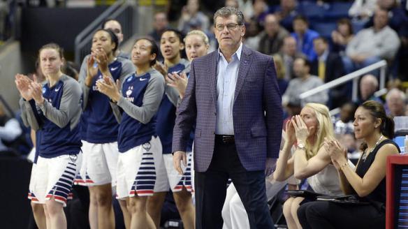 UConn head coach Geno Auriemma and his team. (*photo by Jessica Hill, AP)